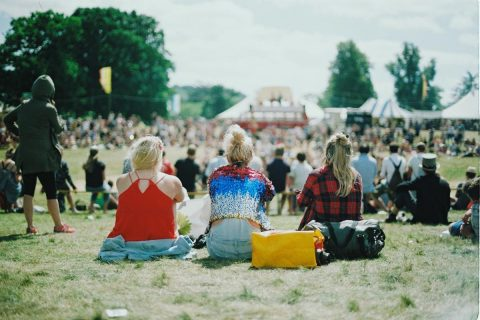girls sitting at a music festival